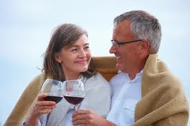 older people drinking wine